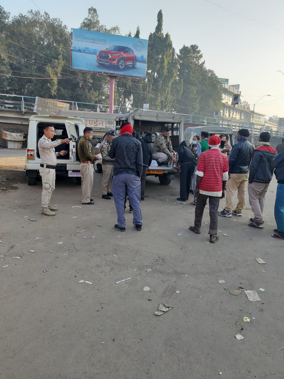 People waiting in line to get their cup of coffee served by Dimapur Police