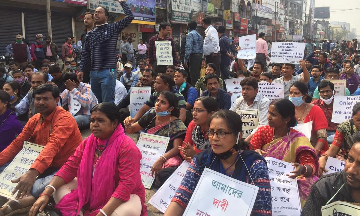 Terminated teachers holding road blockade in front of Agartala City Centre here on Sunday