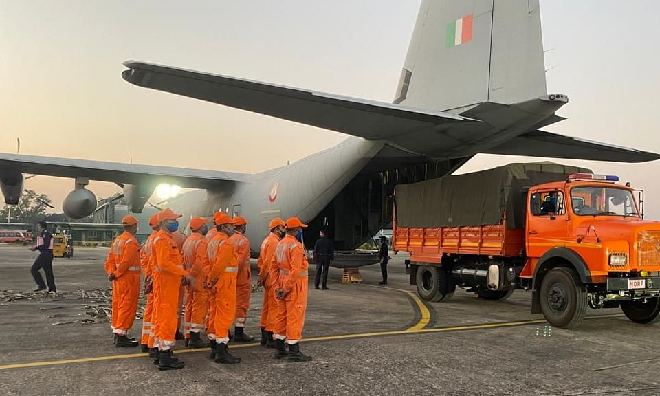 NDRF team at Guwahati , boarding the C 130J along with firefighting equipment