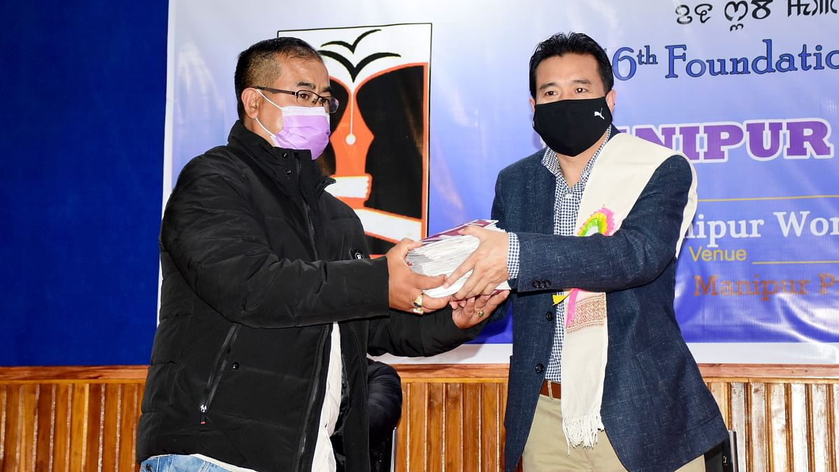 Manipur: Minister Th Biswajit hands over pension books to 57 approved journalists