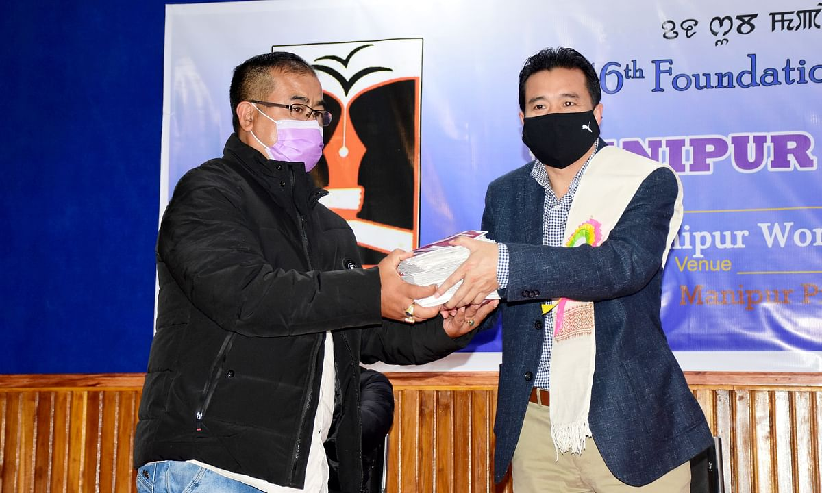 IPR minister Th Biswajit handing over pension books for approved journalists
