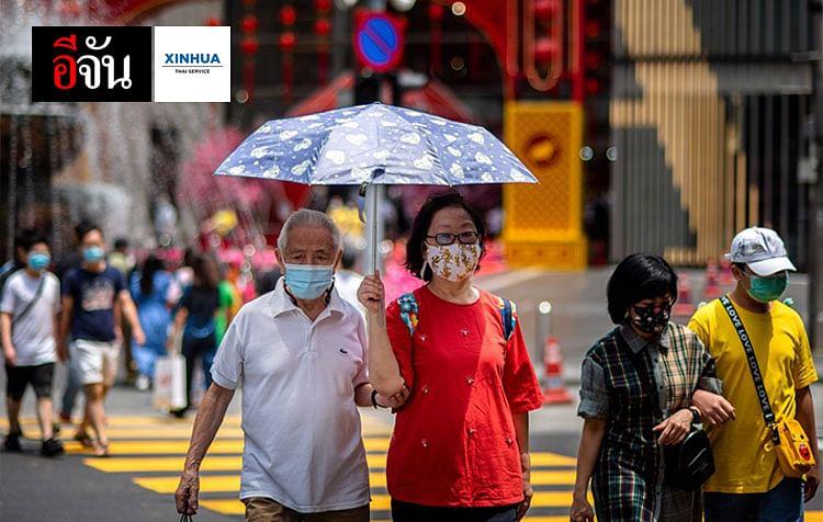 ประชาชนสวมหน้ากากอนามัยระหว่างเดินในกรุงกัวลาลัมเปอร์ เมืองหลวงของมาเลเซีย
