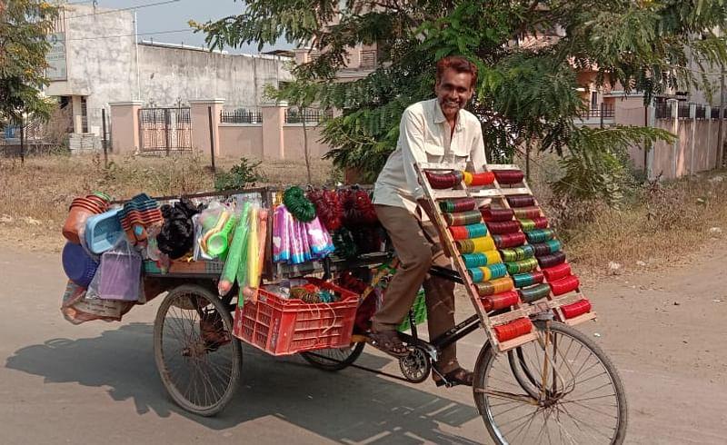 Gulmohammad Sheikh's business runs on a three wheeled rickshaw