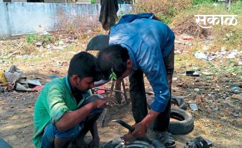 Jahangir Ansari is running a garage overcoming paralysis