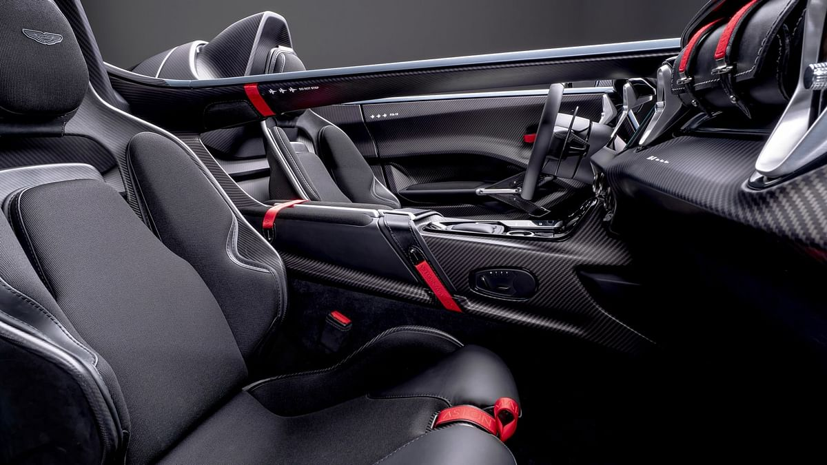 Instead of a glove box there's a removable leather bag, while additional storage space can be found under the rear humps.