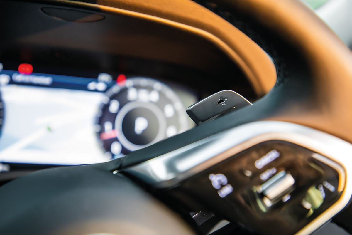 Chunky, three spoke flat-bottom steering wheel (the same one as on the I-Pace) with backlit controls and the brushed aluminium elements on the spokes