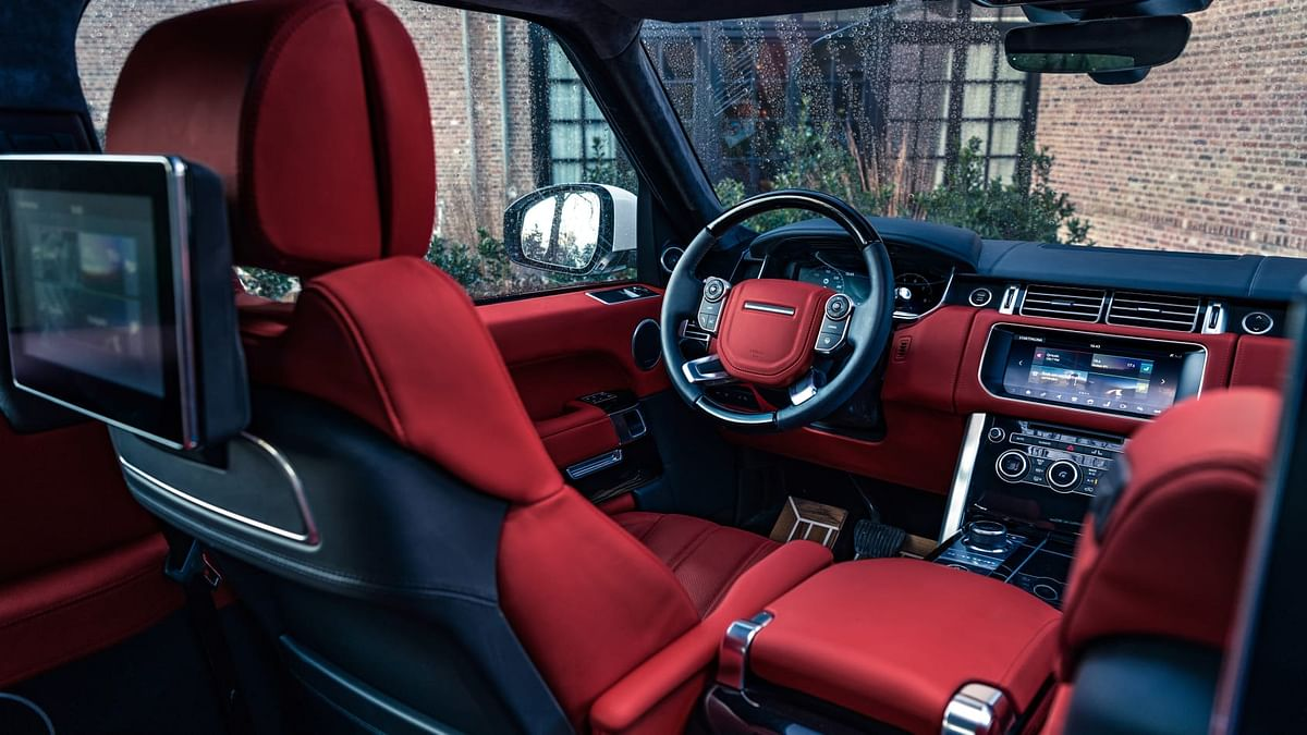 A piano  black dashboard with all leather interiors in red.