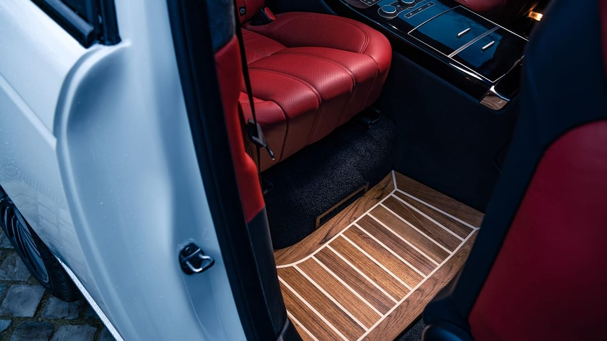 The teak flooring comes as an option but is available throughout the car if availed