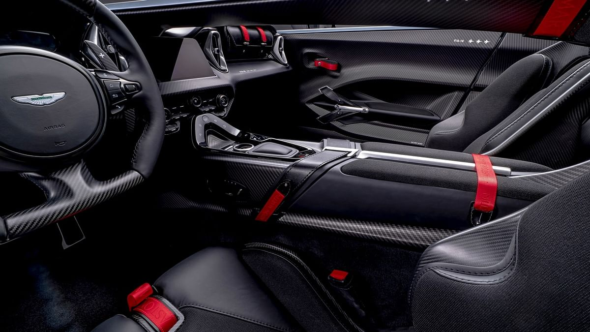 The colour scheme is continued with satin dark chrome, machined aluminium, black leather, black technical textile, black carpets and red Aston Martin scripted door pulls.
