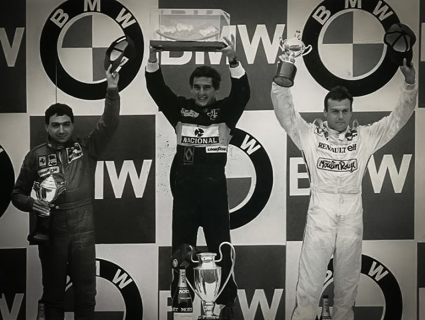 The Estoril GP 1985 podium  (L-R): Michele Alboreto, Ayrton Senna,  Patrick Tambay