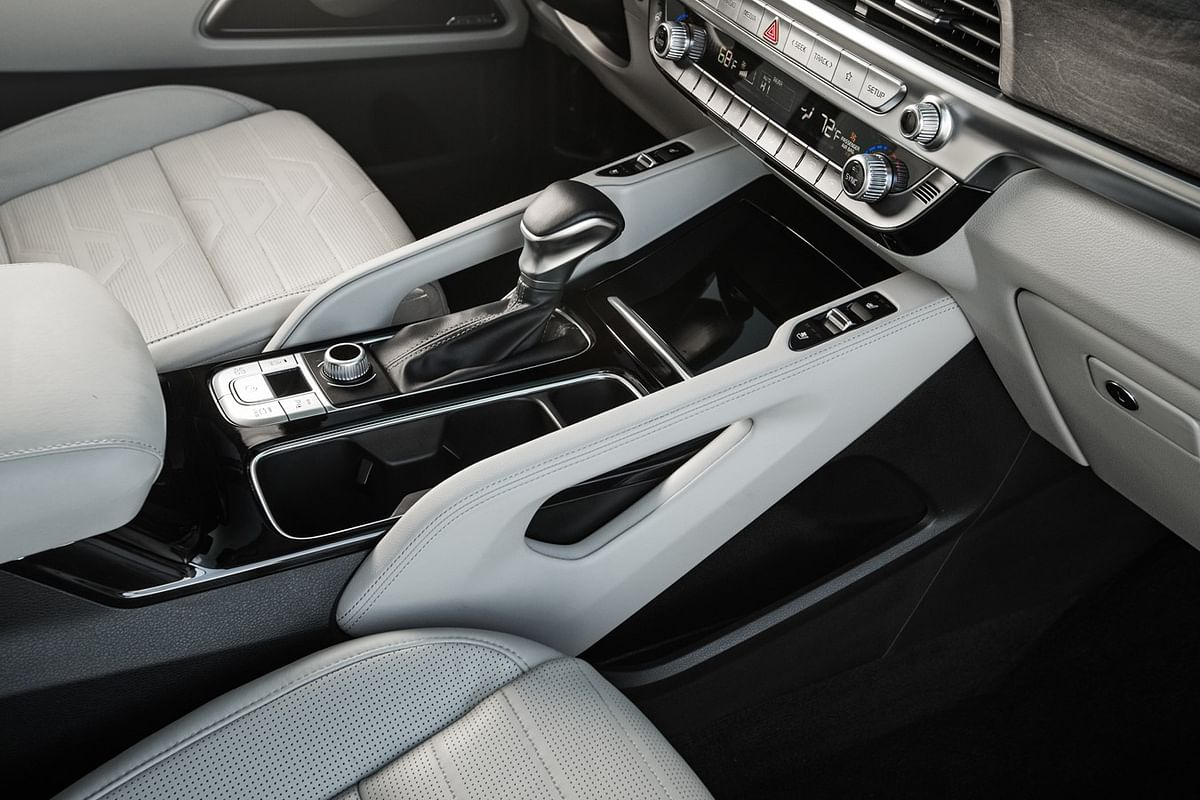 Double stitched Nappa leather with brushed metal and matte wood inserts all around the cabin.