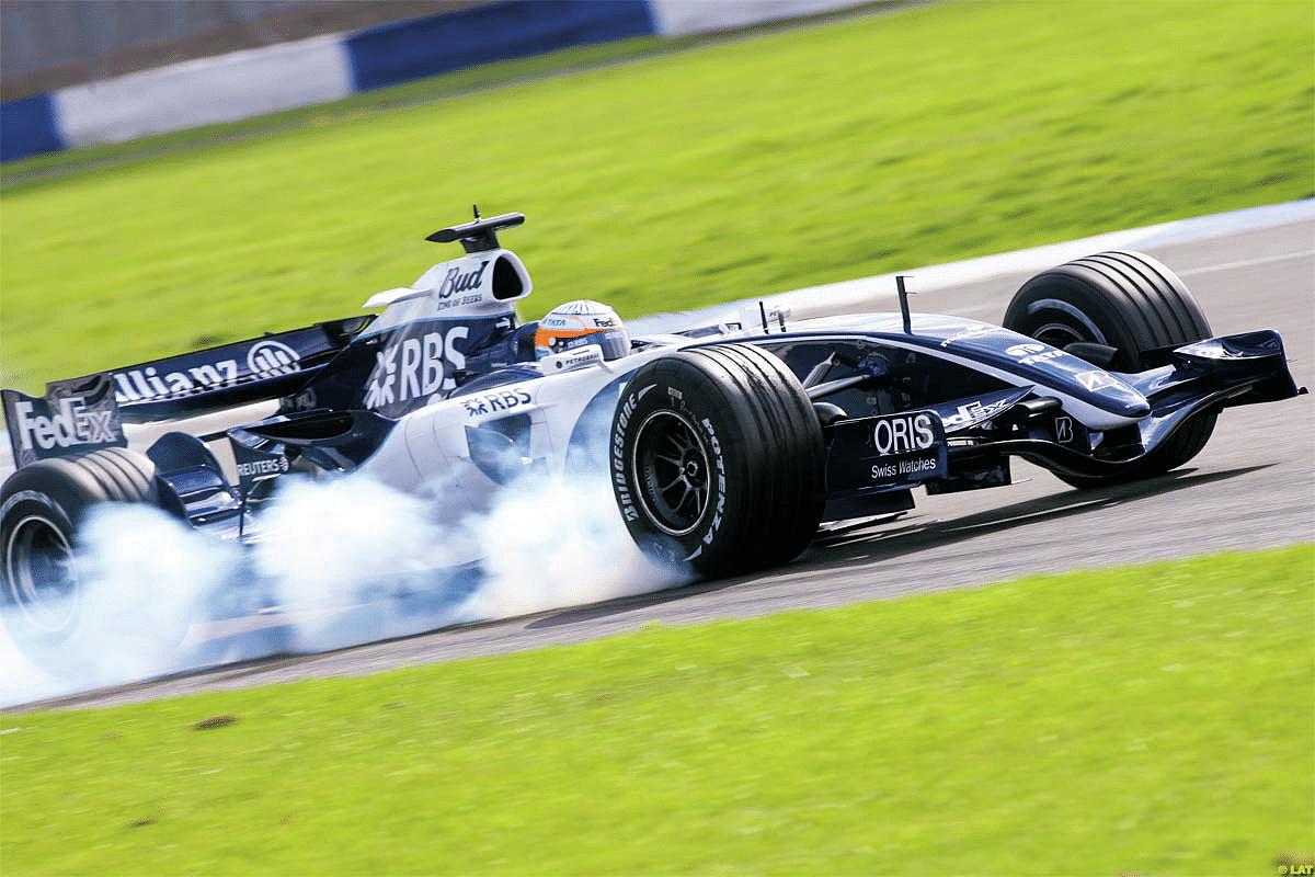 Narain locks a wheel during testing, 2006
