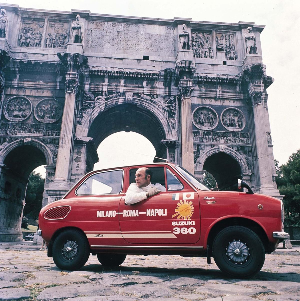 Sir Stirling Moss driving for Suzuki