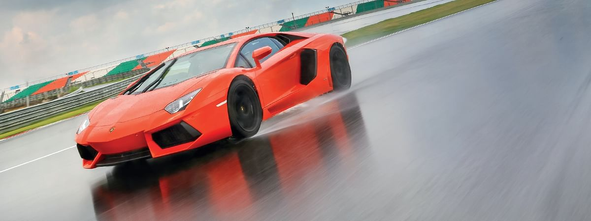 The most exotic car you can buy, in the rain...This is off the charts!