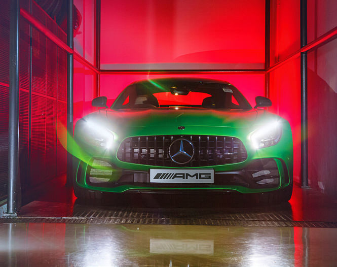 AMG GT R on the lift that takes his cars to the basement garage