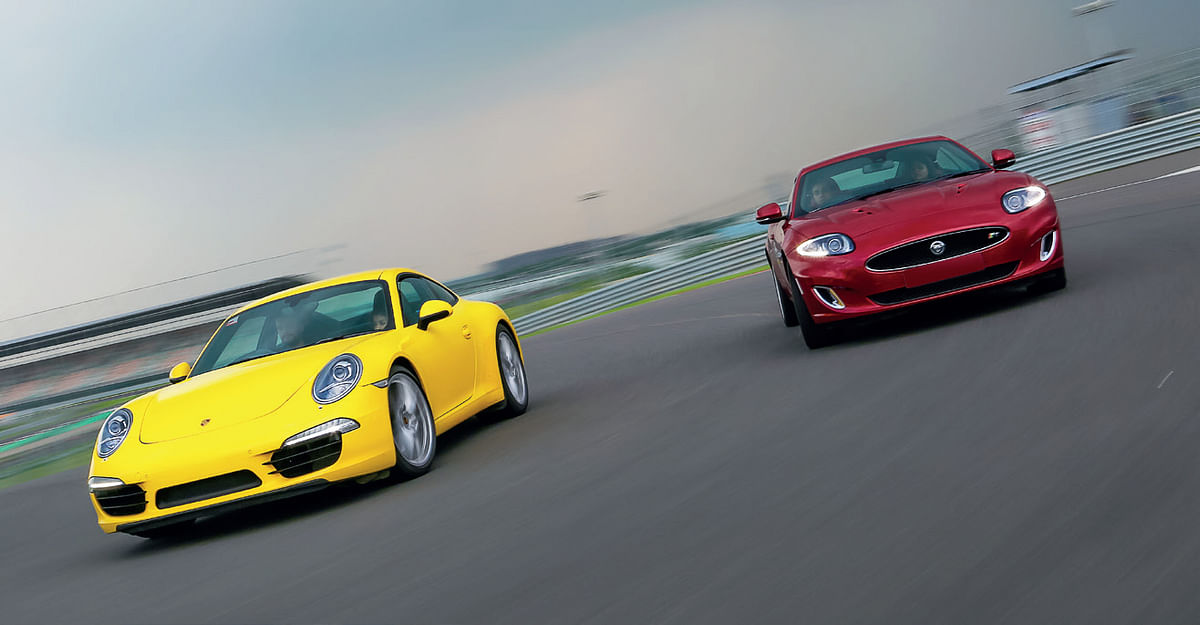 The better-handling 911 easily dives down the inside of the Jag in tight corners