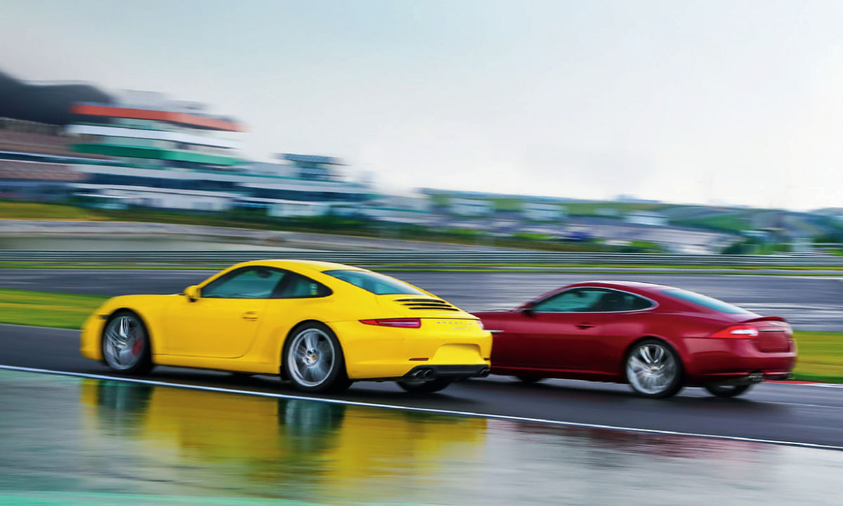 The Porsche always inches just ahead of the  Jag
