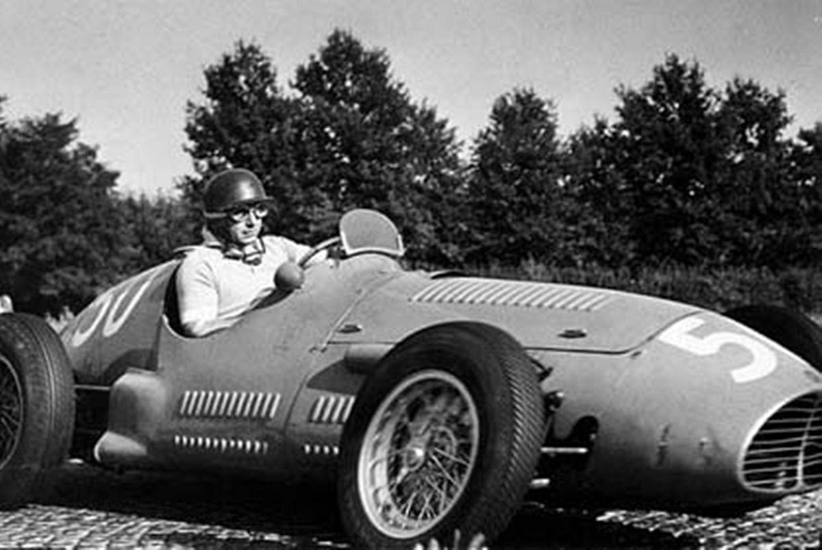 Juan Manuel Fangio pushing his Maserati to eventual victory at Monza, 1953