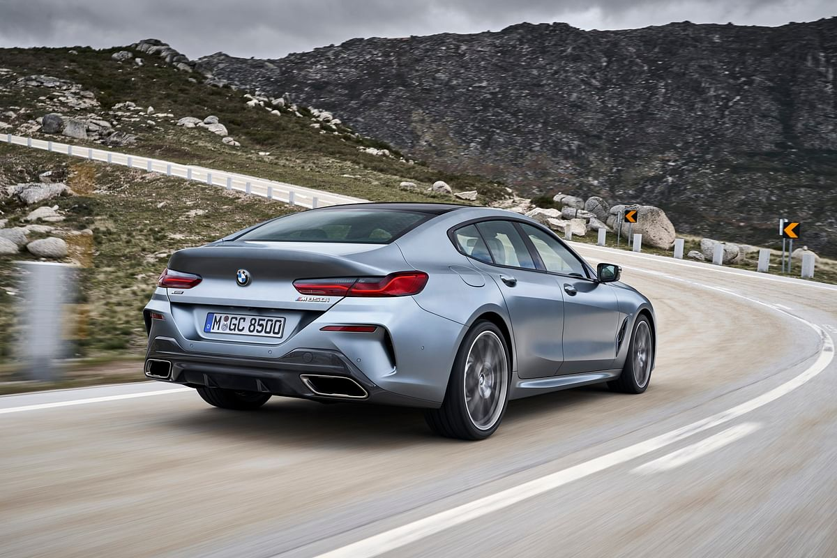Dual exhausts, neatly flowing coupe roofline and slender tail lamps on the 8 Series Gran Coupe
