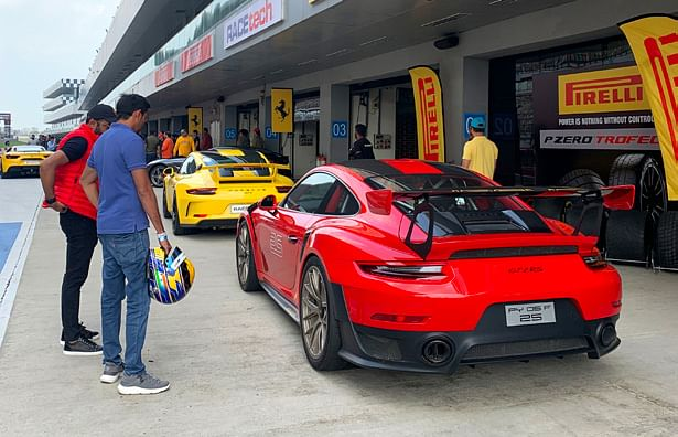 Getting track training from Aditya Patel in the GT 2 RS