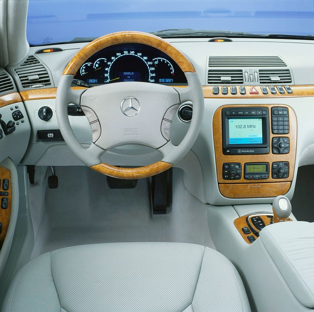 1998: The multifunction steering wheel.  Also seen are audio devices, the car phone, and navigation