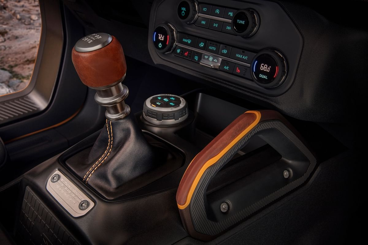 Grab handles next to 7-speed manual transmission a boon when going over rough terrain