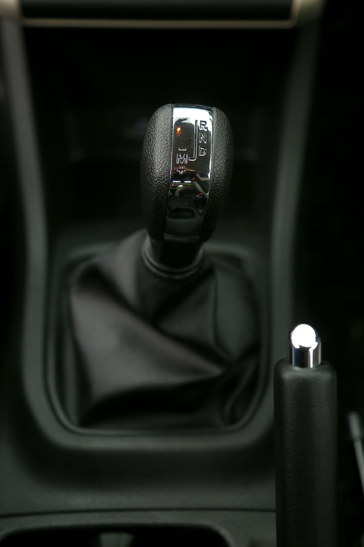 The AMT variant gets silver-ish accents on the gear lever, earlier seen on Duster AMT