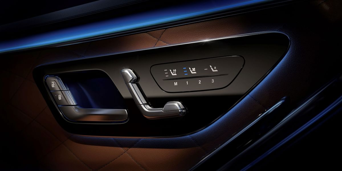 Ambient lights engulf the climate control buttons in the doors