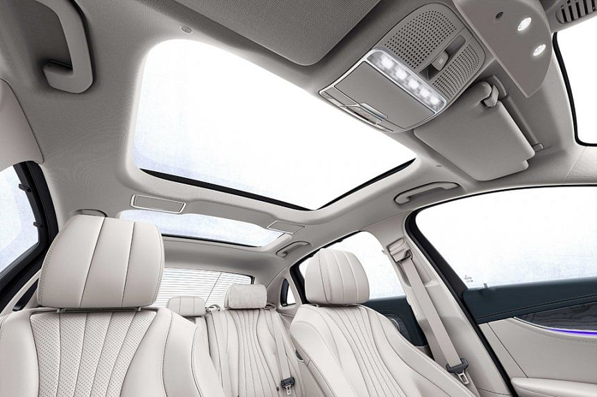 Panoramic glass roof and bright-coloured upholstery gives yacht-like feeling