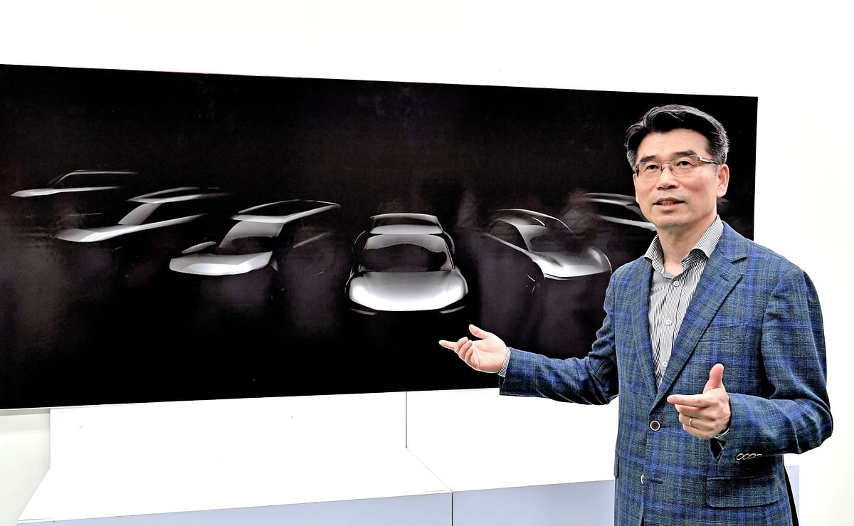 Ho Sung Song, President and CEO Kia Motors unveiling the sketches of the future EVs from Kia