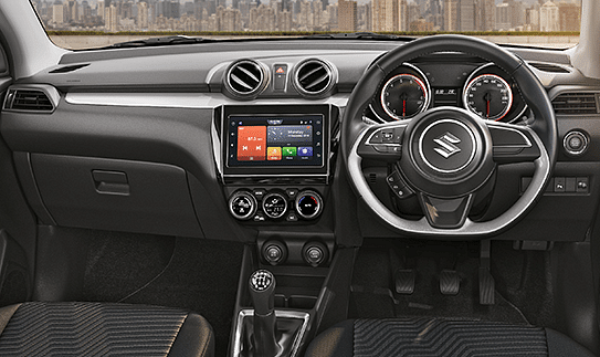All-black interiors with a flat-bottomed steering wheel