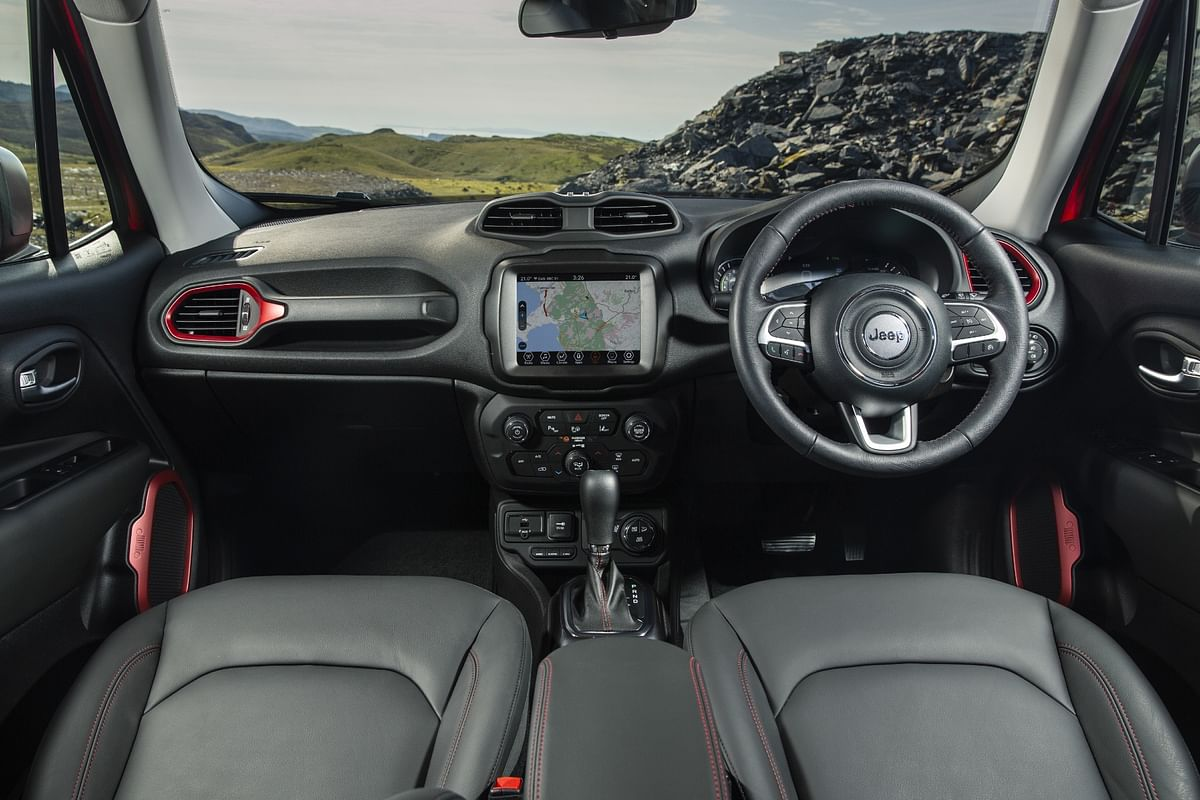 Red accents on the interiors of the Renegade 4xe Trailhawk