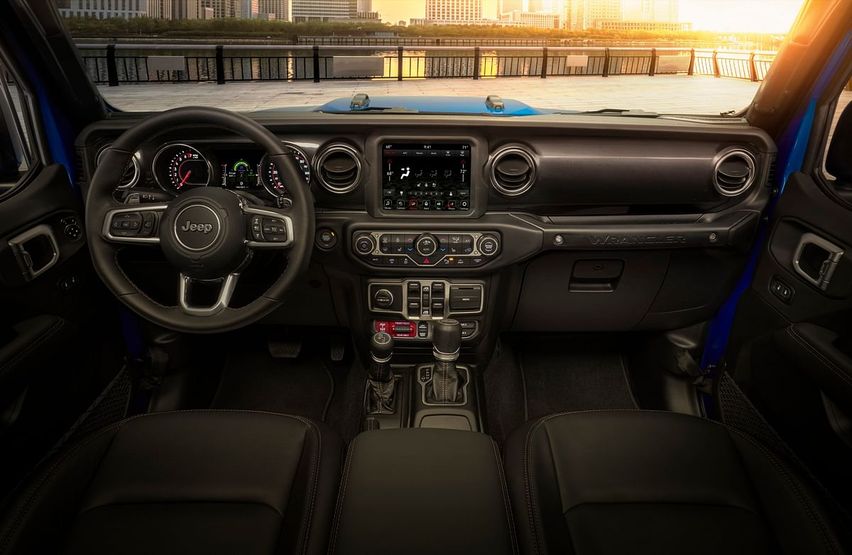 A Wrangler-first leather wrapped steering wheel and a separate gauge cluster for the engine