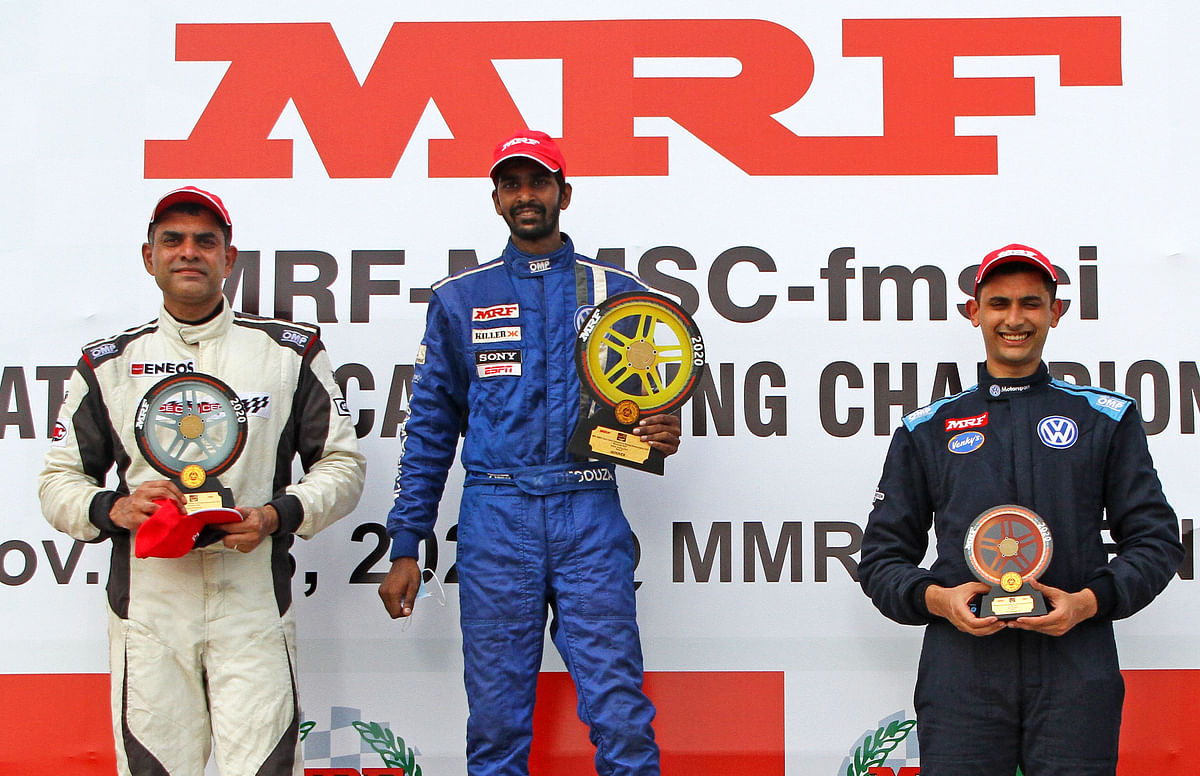 Keith D'Souza, winner, race 3, ITC class, flanked by second-placed Arjun Balu (left) and third-placed Jeet  Jhabakh