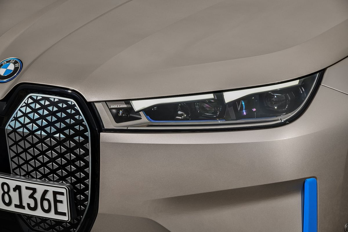 Blacked-out grille packs the necessary tech for autonomous driving, and its size keeps with the current BMW design aesthetic