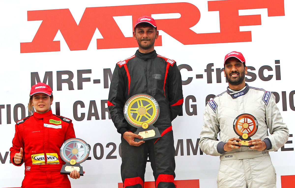 Raghul Rangasamy, winner, race 2, Super Stock class, flanked by second-placed Alisha Abdullah (left) and third-placed Vineet Abhiram
