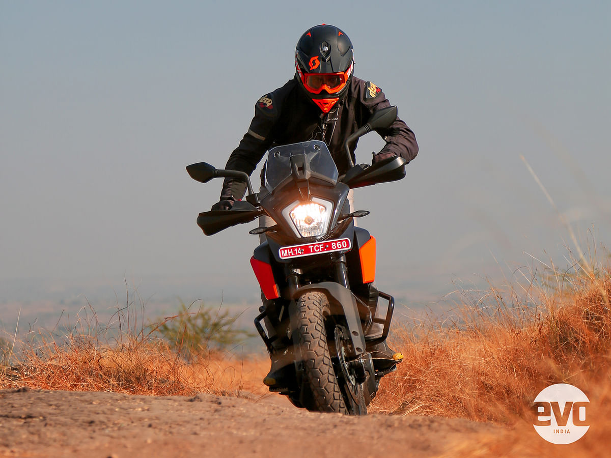 The standing-up riding position is awkward with slightly forward facing footpegs