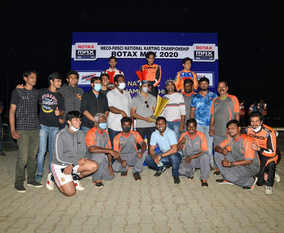 Senior Max class winner Arjun Maini with runner-up Shahan Ali Mohsin and Mihir Suman Avalakki, along with Team Champions NK Racing Academy (sitting)