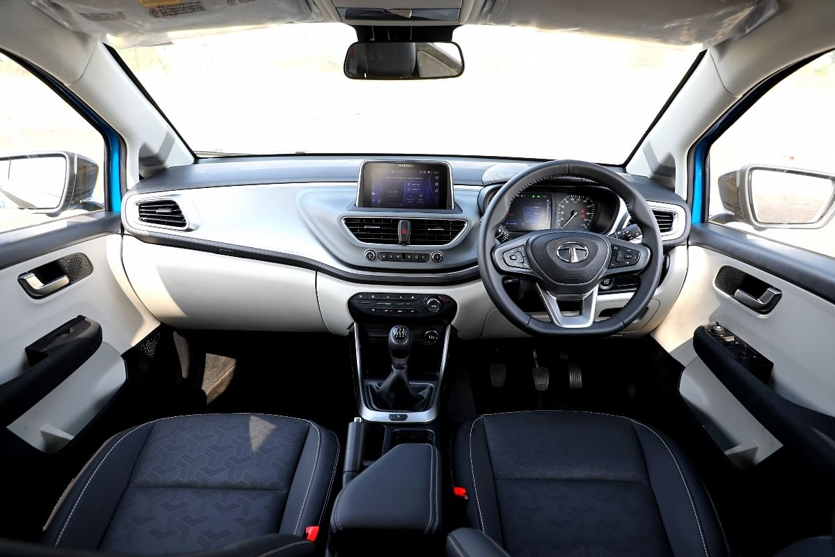 Light grey plastics and leatherette seats improve the experience inside