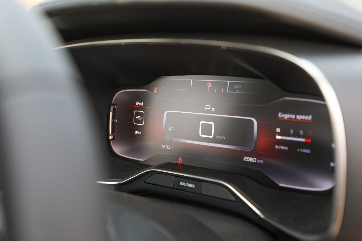The 12.3-inch digital cockpit with a digital speedo in the centre and a retro-themed horizontal tacho above it