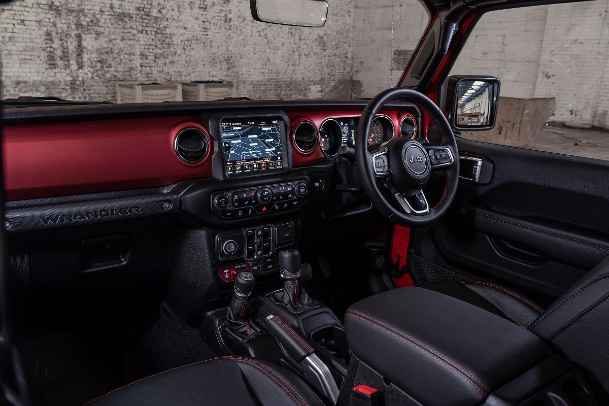 The interior of the Wrangler 1941 remains similar to that of the Rubicon, but gets a colored dash and stitching from the Unlimited model