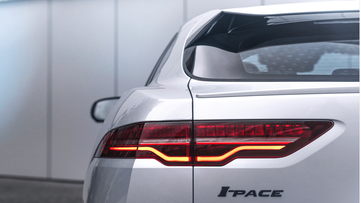 The rear gets sleek LED taillights and a coupe-like raked windshield