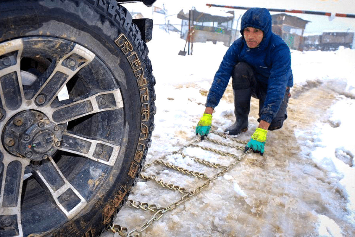 Putting on snow chains