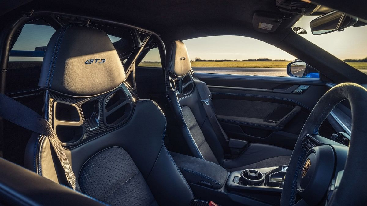 The new 911 GT3 gets sports seats and a half roll cage