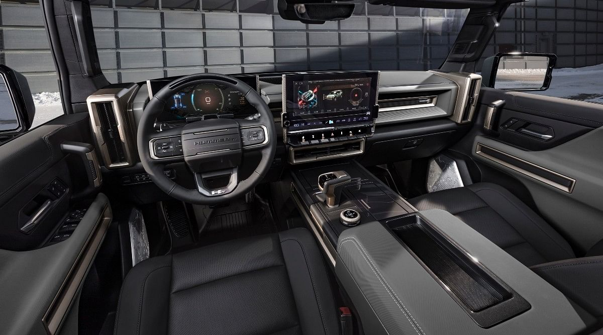 The Hummer EV SUV gets bronze accents on the inside