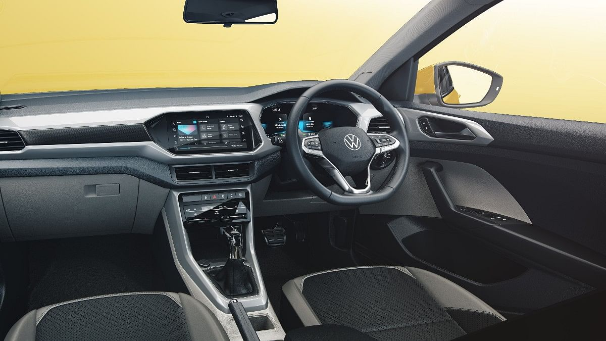 The Volkswagen Taigun gets a dual tone interior with a central infotainment touchscreen