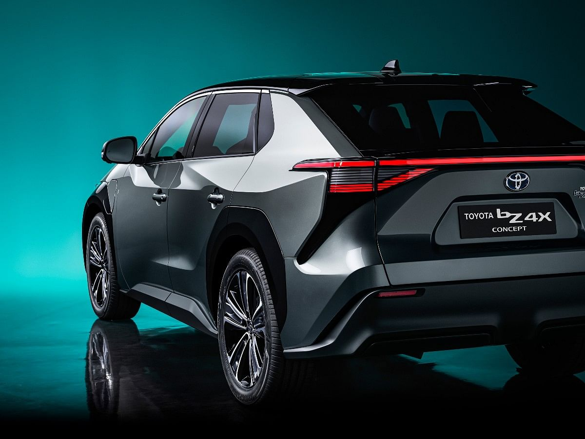 The Toyota bZ4X concept gets a full-width LED light bar and a raked windscreen at the rear