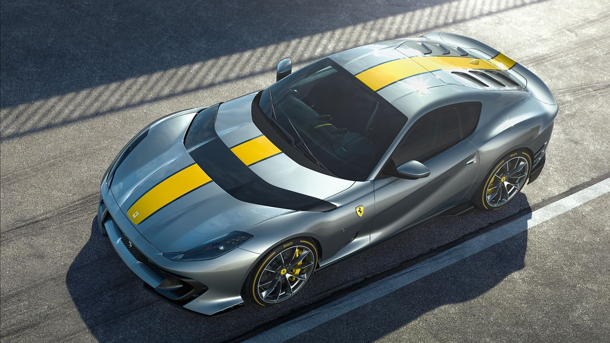 The Ferrari 812 Competizione gets a carbonfibre wing that splits the bonnet and channels air from the front through the inside of the engine bay