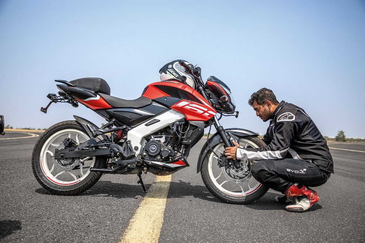 The Pulsar NS 160's rear disc is crucial for Hrishi to be able to control the wheelie
