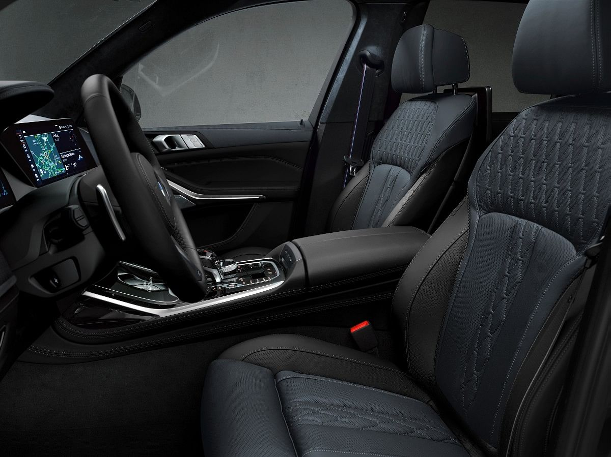 The X7 Dark Shadow Edition gets Blue Nappa over Merino Black leather upholstery